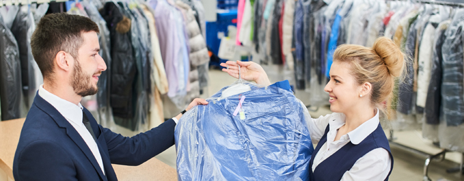 Lady handing over dry cleaning